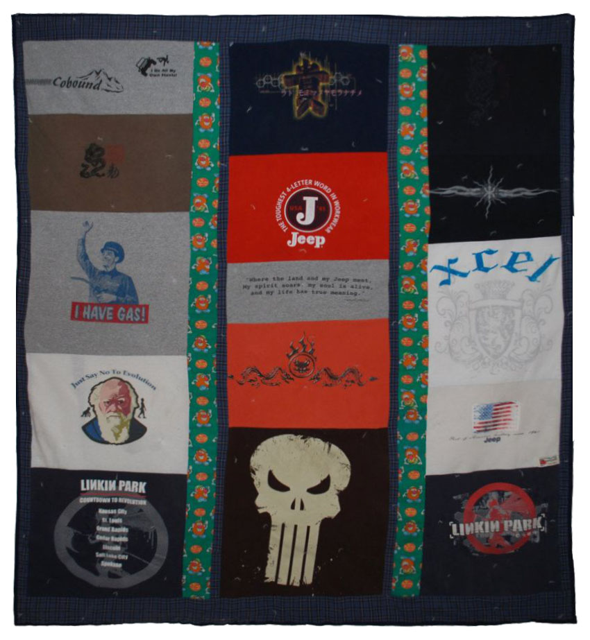 Memorial quilt made out of Chad's t-shirts and pajama pants.