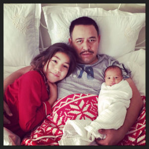 Baby Emiliana Avalos with her big sister, Natalia, and father.