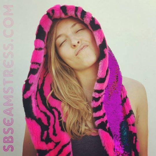 Megan Illgner models a pink flip sequin tiger hood